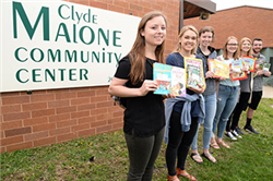 Honors Academy Students Encourage Reading at Malone Center