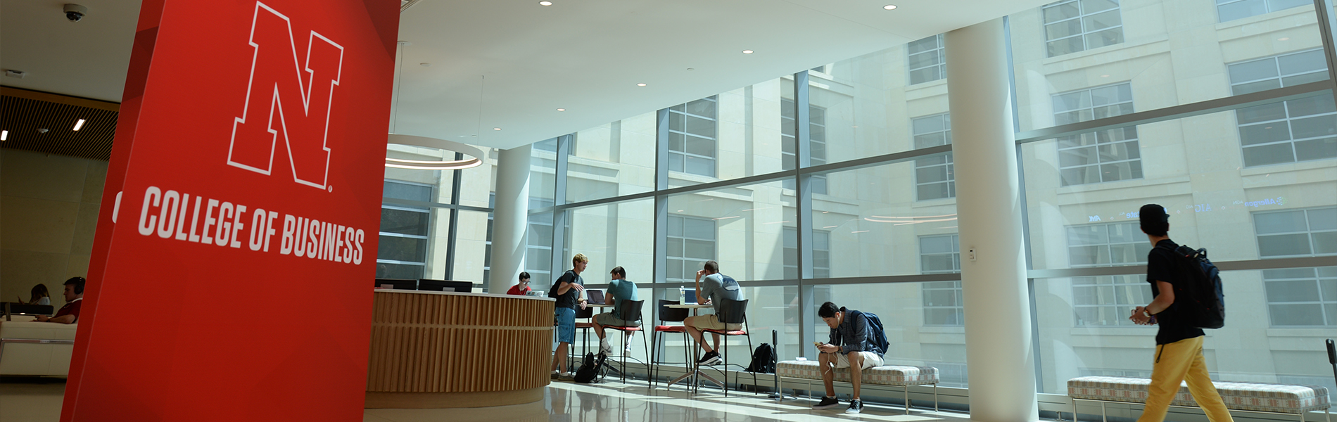 Students gather inside the new College of Business building